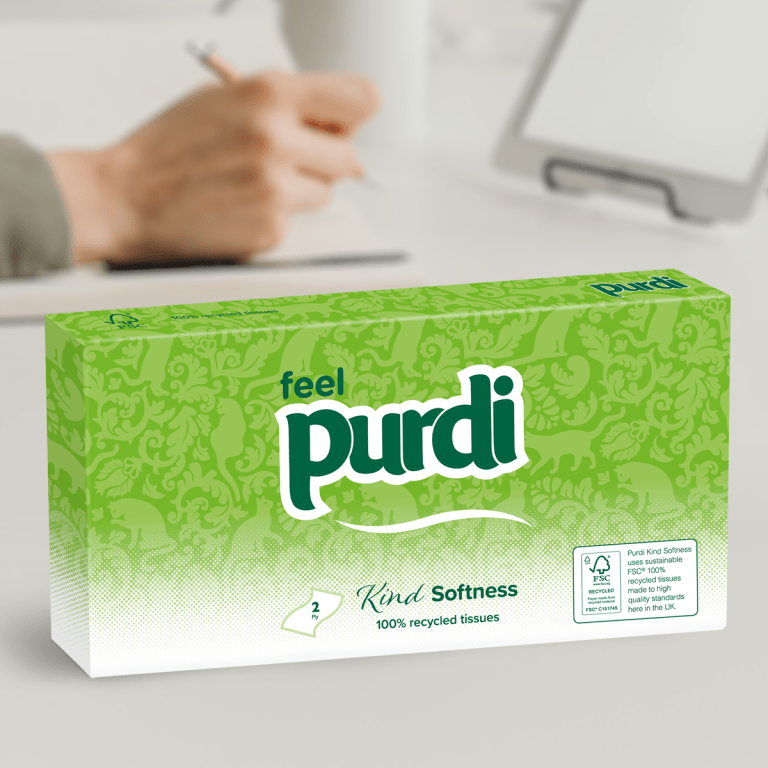 Kind Softness facial tissue package sitting on desk
