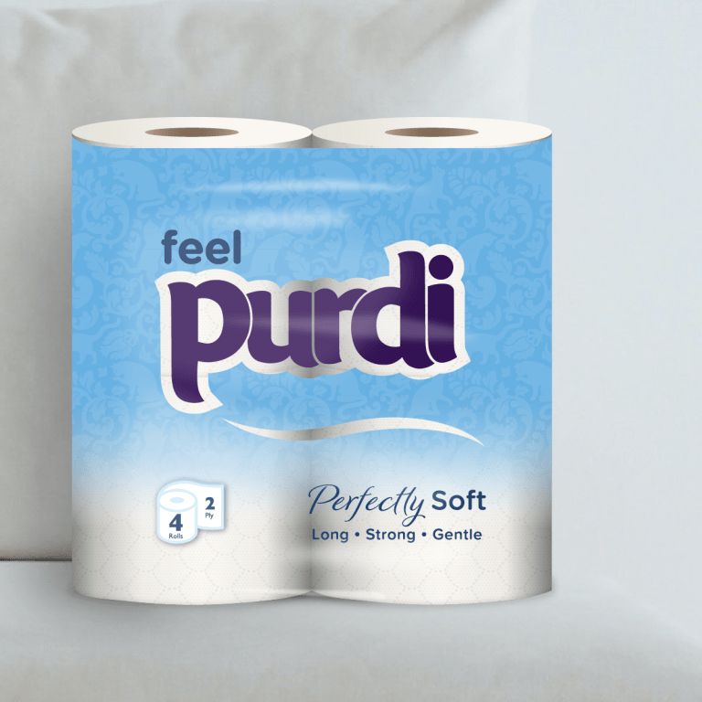 Perfectly Soft toilet roll package sitting on plush sofa